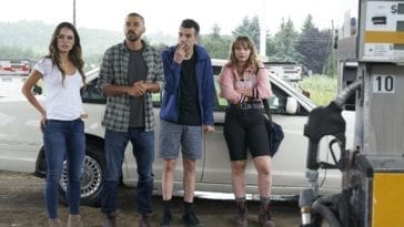 Kathy, Todd, Ezra, and Aurora stand at a gas station wondering what to do.