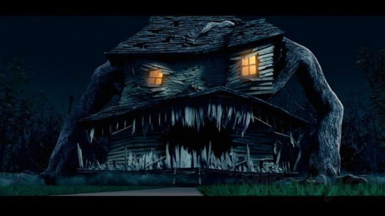 Monster House with teeth and the windows acting as eyes, with arms on either side as it chases the kids in Monster House