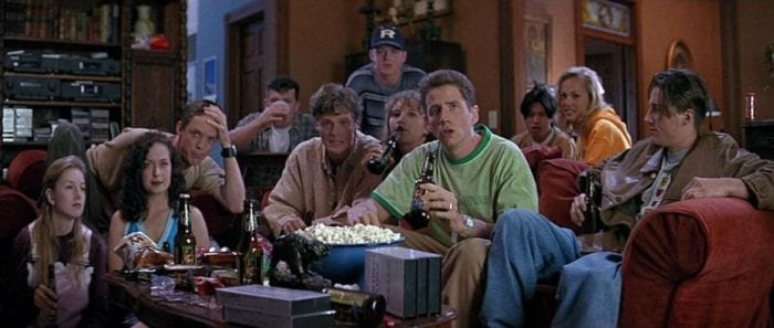 Randy and a group of highschoolers watch a movie while at a party.