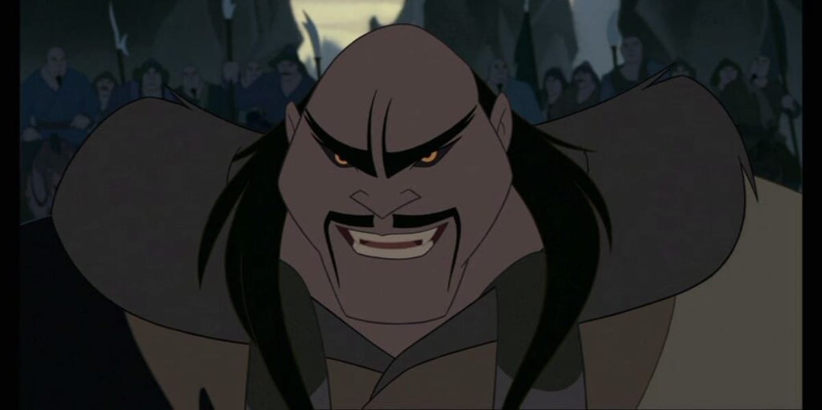 Shan Yu glaring with a smile, the Huns behind him in Mulan