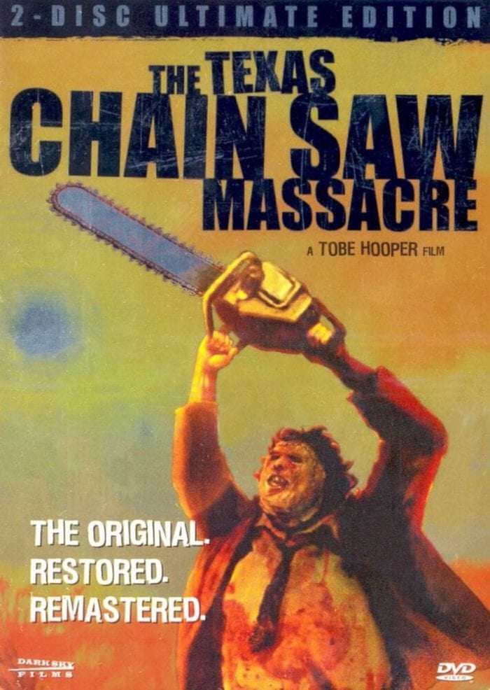 DVD Cover of The Texas Chainsaw Massacre. Leatherface wields his signature chainsaw, flailing about.