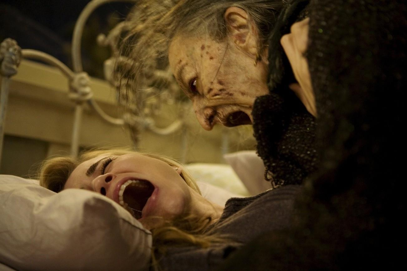 Christine is attacked by a witch while sleeping.