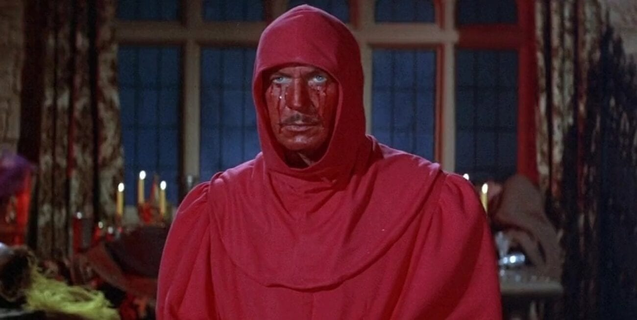 Prince Prospero is dressed in a red robe and hood with his face painted red.