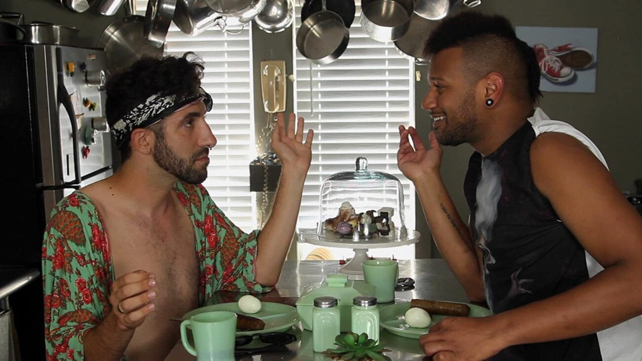 Roommates Brian (Christopher Dalpe) and Dwayne (Wayne Gonsalves) sit at their kitchen island over breakfast chatting.