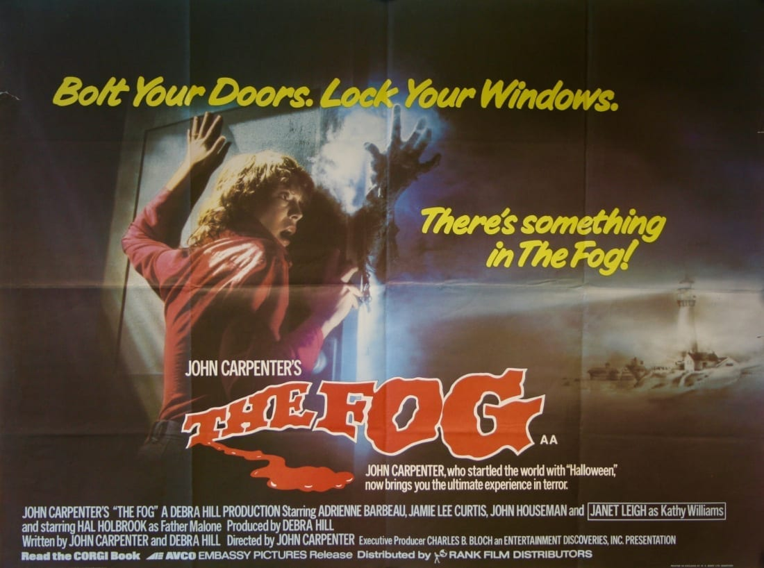 poster for the John Carpentar movie the fog, showing an actress jamie lee curtis holding back a door opening with a skeletal arm sticking through