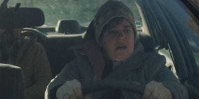 Bettina (Rebecca Drysdale) as the bumbling Uber driver, drives her taxi in the cold.