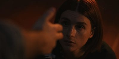 Fred (Josh Ruben) points finger guns at Fanny (Aya Cash).