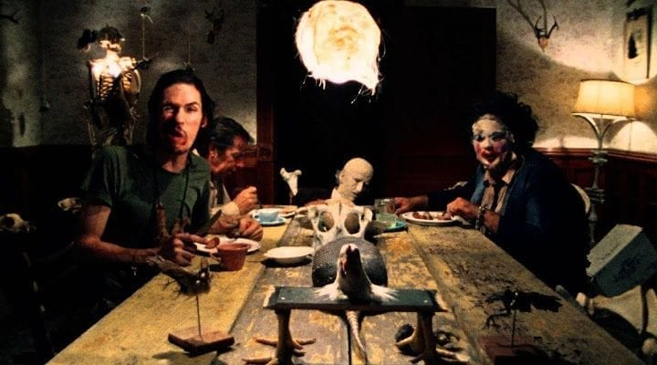 Leatherface and family sitting around the dinner table