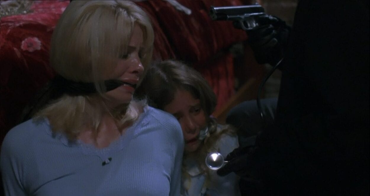 Alison and Diana Gordon held hostage/at gun-point by Zepp.