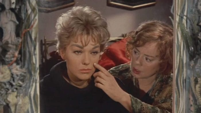 Kim Novak sheds a tear in the mirror while Elsa Lanchester wipes it away
