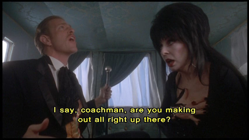 """Dr. Bradley Bradley (Scott Atkinson) in a carriage saying, """"I say, coachman, are you making out all right up there?"""", in the film, """"Elvira's Haunted Hills"""" (2001)."""