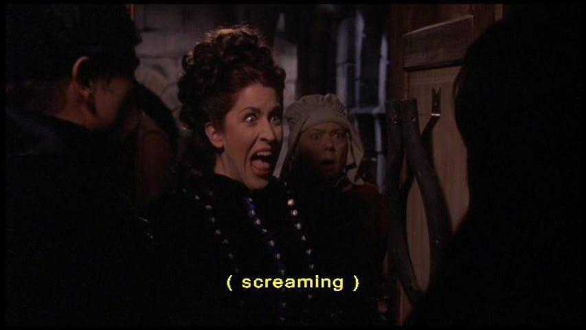 "Lady Ema Hellsubus (Mary Scheer) screams in the film, ""Elvira's Haunted Hills"" (2001)."