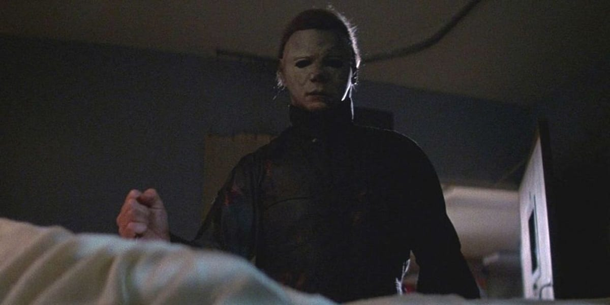 Michael creeps up on a hospital bed, readying an attack on Laurie.