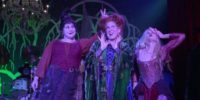 "Mary (Kathy Najimy), Winifred (Bette Midler), and Sarah (Sarah Jessica Parker) Sanderson sing a song, with Mary putting two fingers up behind Winifred's head, in the film, ""Hocus Pocus"" (1993)."