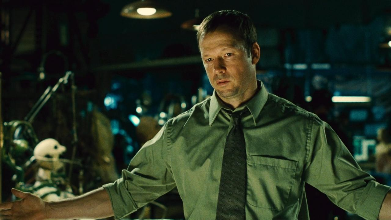 Donnie Wahlberg as Detective Matthews holding his arms out