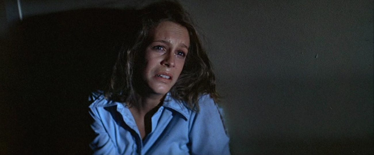 Jamie Lee Curtis sits in her pajamas and looks up frightened.