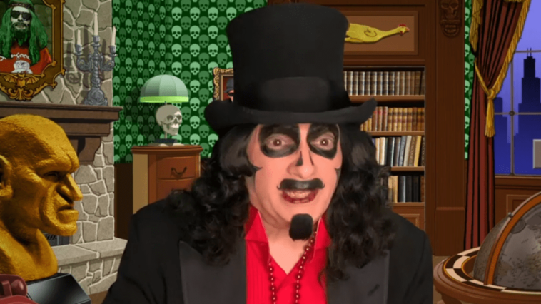"Svengoolie (Rich Koz) appears in a commercial for his showing of ""The Devil-Doll"" (1936) on MeTV."