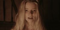 Close up of a young woman with long blonde hair, and blood on her face and neck.