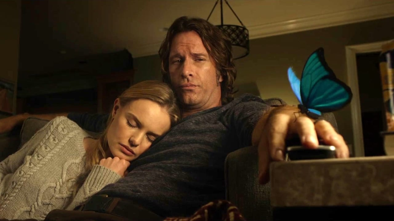 Mark and Jessie Hobson on a couch with a butterfly on Mark's hand