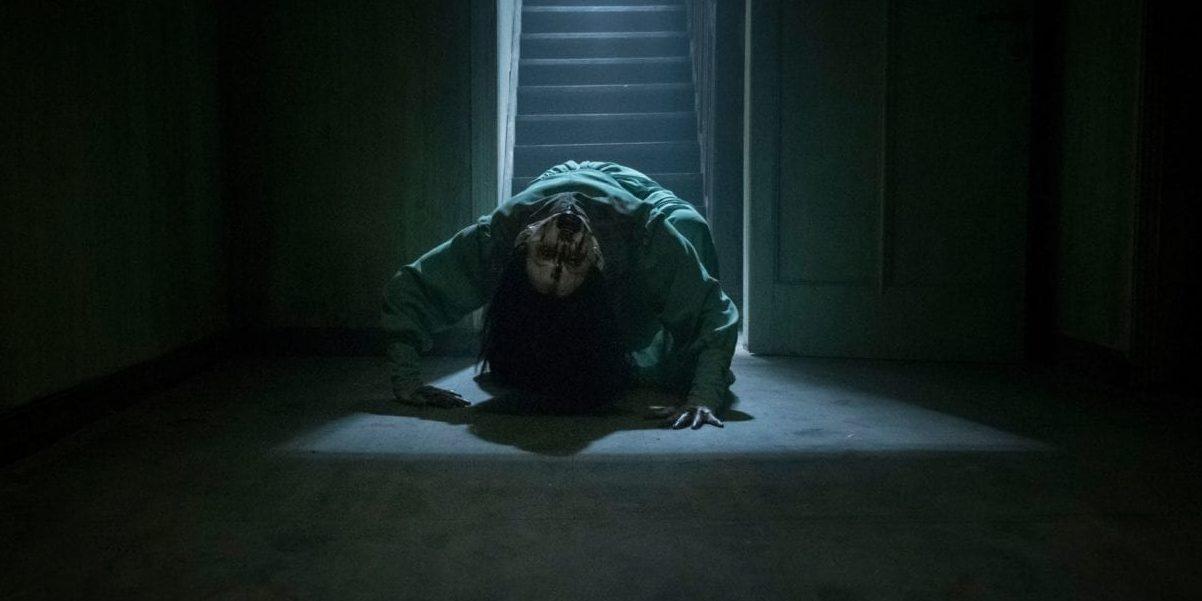 Possessed spirit backwards walks down the stairs.
