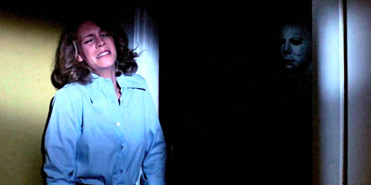 Michael pokes out from the darkness as Laurie is trying to regain some composure.