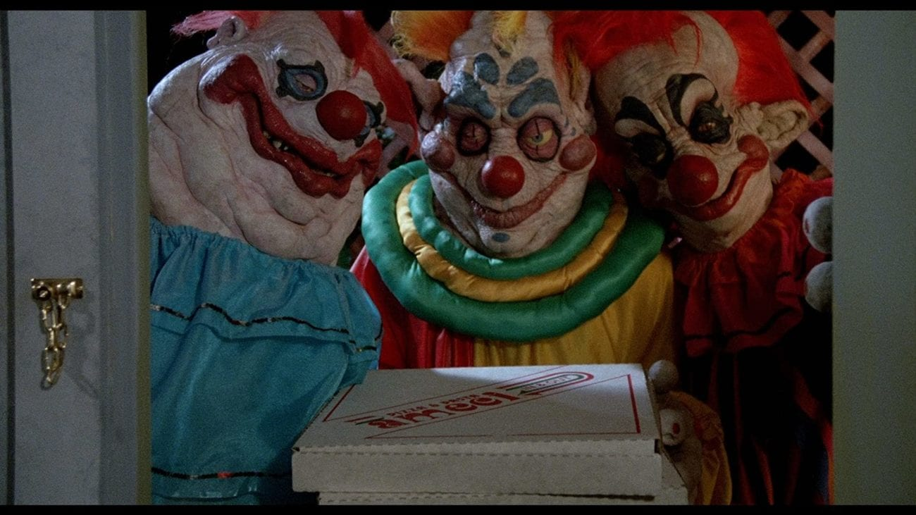 Three clown aliens at the door with a pizza box