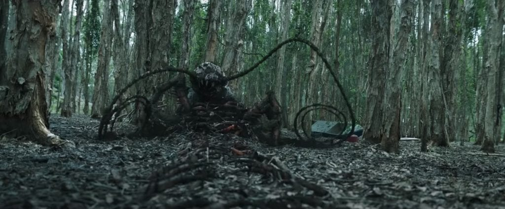 A monster coming out of the ground.