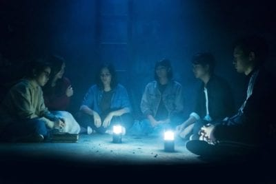 The group performs a black magic ritual.