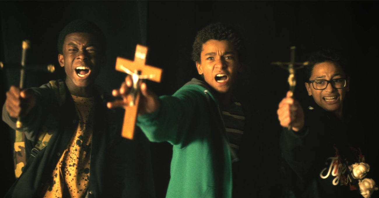 Three kids holding crosses