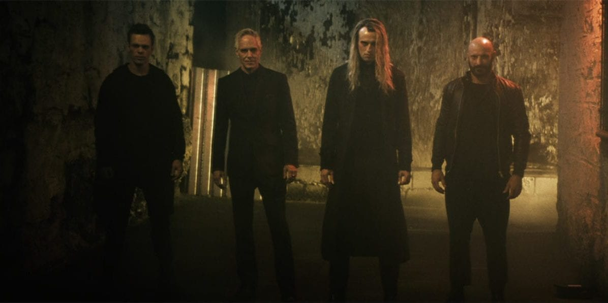 Four vampires standing side by side