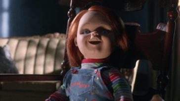 Chucky sits in doll state in a chair.