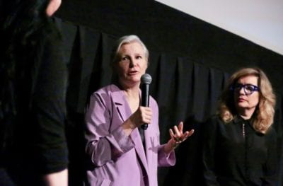 Mary Harron speaks into a microphone.