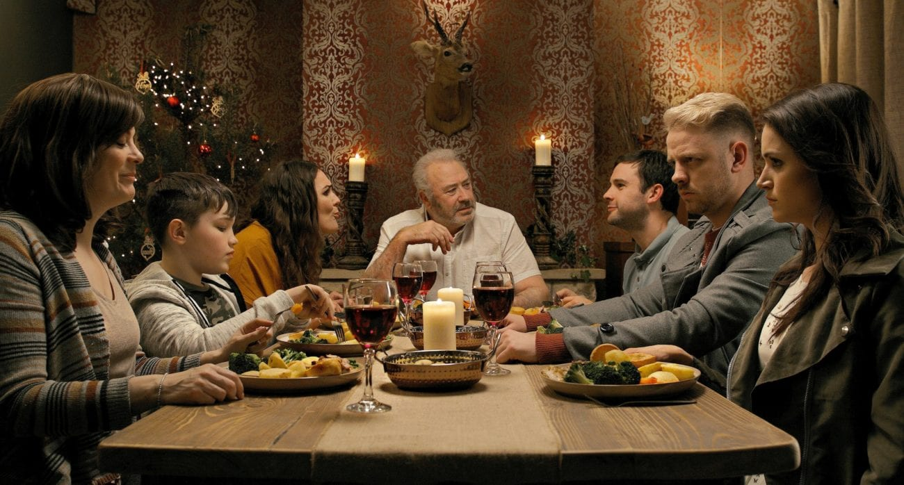 A family sits at a table for Christmas eve dinner unaware events are about to turn deadly