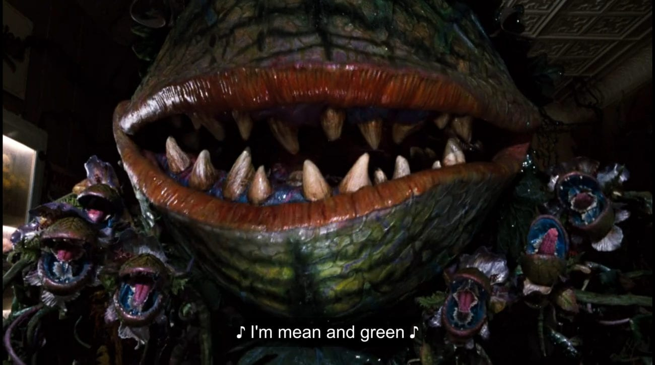 """Carnivorous plant Audrey II (Levi Stubbs) and a series of carnivorous plant buds sing, """"I'm mean and green,"""" in the film, """"Little Shop of Horrors"""" (1986)."""