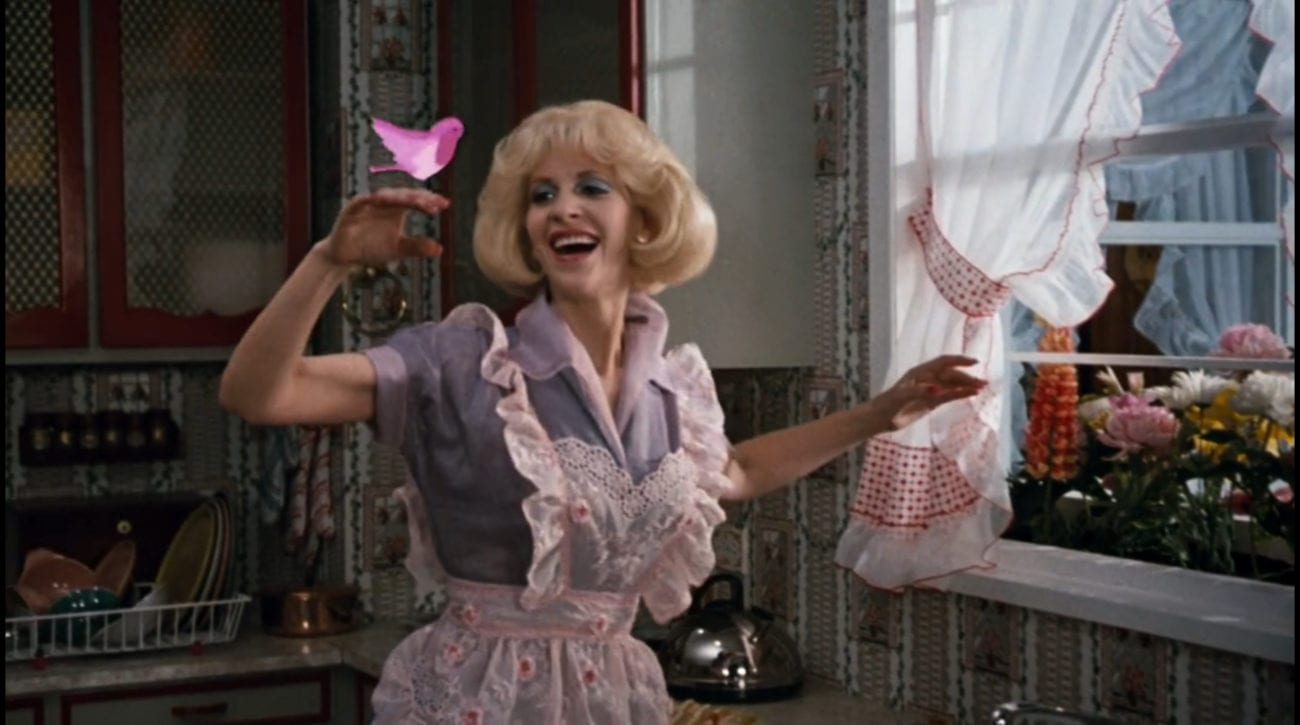 """Audrey (Ellen Greene) holds up her hand, a pink animated bird perched on it, in the film, """"Little Shop of Horrors"""" (1986)."""
