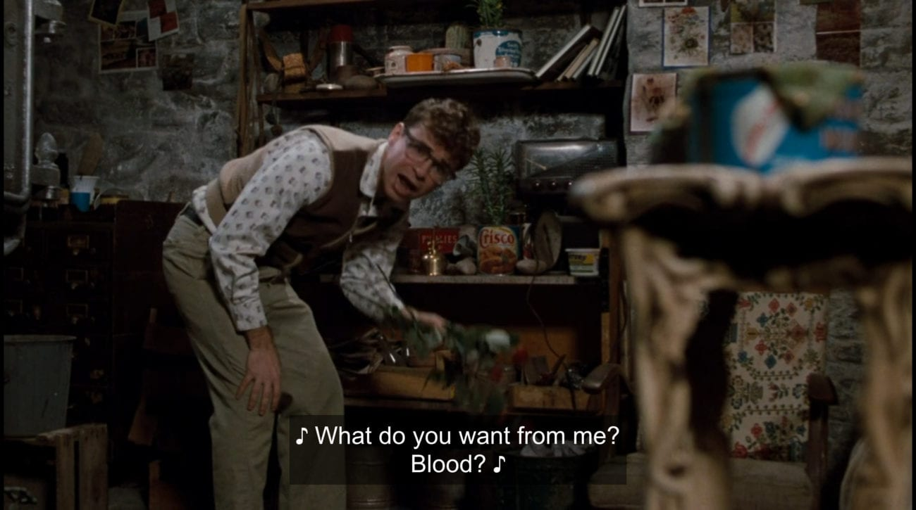 """Seymour Krelborn (Rick Moranis) sings, """"What do you want from me? Blood?"""" in the film, """"Little Shop of Horrors"""" (1986)."""