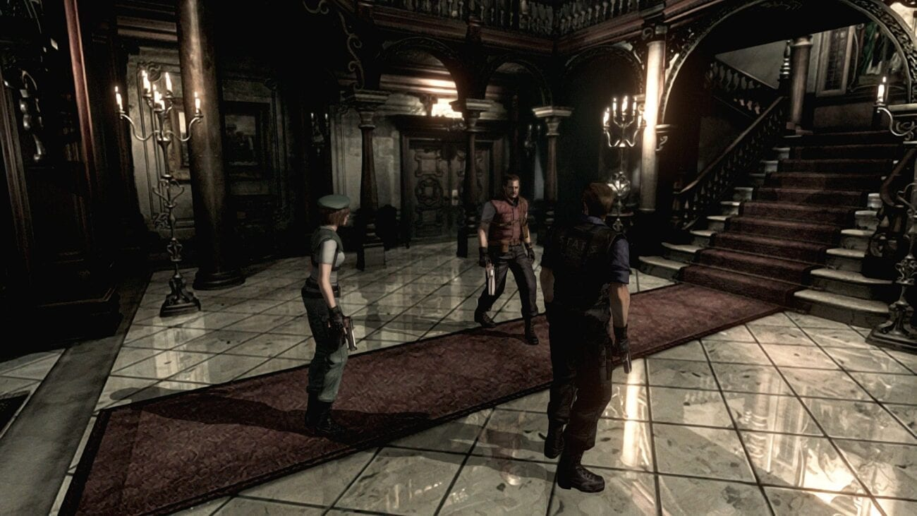 Jill, Barry, and Albert Wesker stand in the Spencer Mansion's entrance