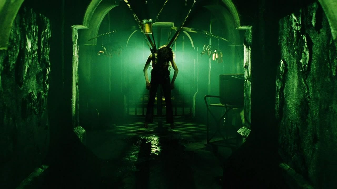 Kerry hanging from her trap in Saw 3