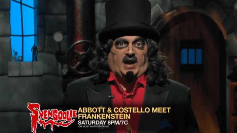 """Svengoolie (Rich Koz) stands in his dungeon in a commercial for his showing of """"Abbott and Costello Meet Frankenstein"""" (1948) on MeTV."""