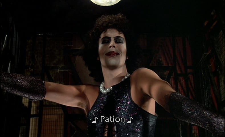 "Dr. Frank N. Furter (Tim Curry) finishes his sentence and says, ""Pation,"" in the film, ""The Rocky Horror Picture Show"" (1975)."