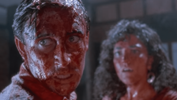 Lionel and Paquita, covered in blood and guts, look past the camera