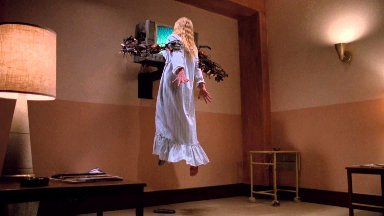 Jennifer is held up in the air by a tvs robotic arms.