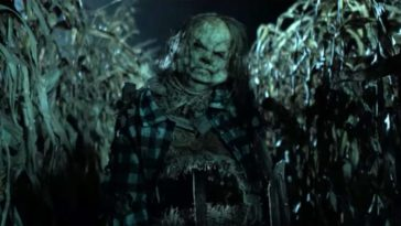 A zombified scarecrow in a corn field.