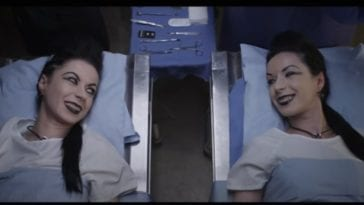 Soska sisters lie on hospital beds and smile at one another in American Mary.