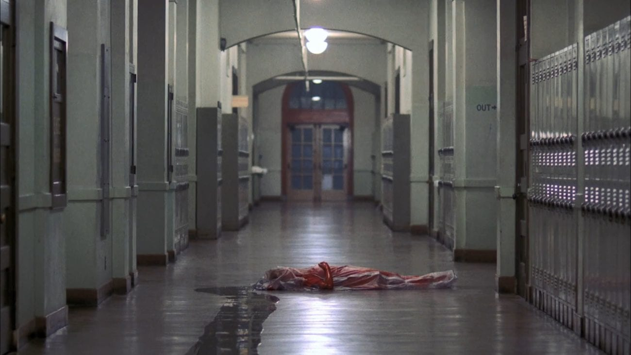 Tina in a bodybag in a pool of blood on the floor of a high school hallway.