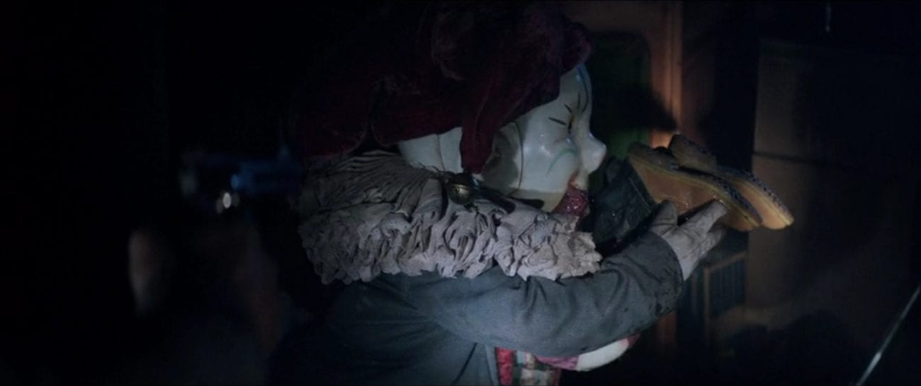 "Der Klown the jack-in-the-box swallows Jordan (Queenie Samuel), with just her feet sticking out of his mouth, in the film, ""Krampus"" (2015)."
