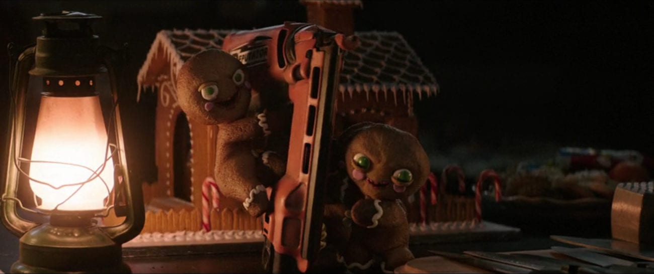 "Three living gingerbread cookies work together to hold up a nail gun in the film, ""Krampus"" (2015)."