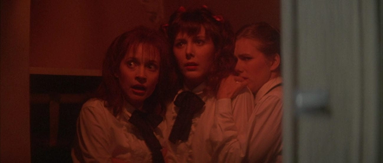 "Three high school girls (Mary Albee, Brynn Baron, Julie Merrill) cower together in a pantry in the film, ""The Monster Squad"" (1987)."