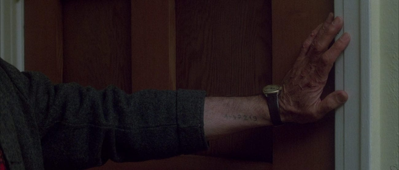 "Scary German Guy (Leonardo Cimino) closes his front door. There's a concentration camp number tattooed on his forearm. From the film, ""The Monster Squad"" (1987)."