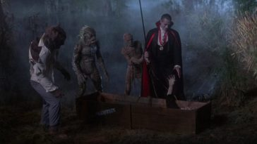 "Wolfman (Jonathan Gries), Gillman (Tom Woodruff, Jr.), and the Mummy (Michael Reid MackKay) look on as Count Dracula (Duncan Regehr) reaches down toward the extended hand of the Frankenstein monster (Tom Noonan), who's lying in a crate, in the film, ""The Monster Squad"" (1987)."
